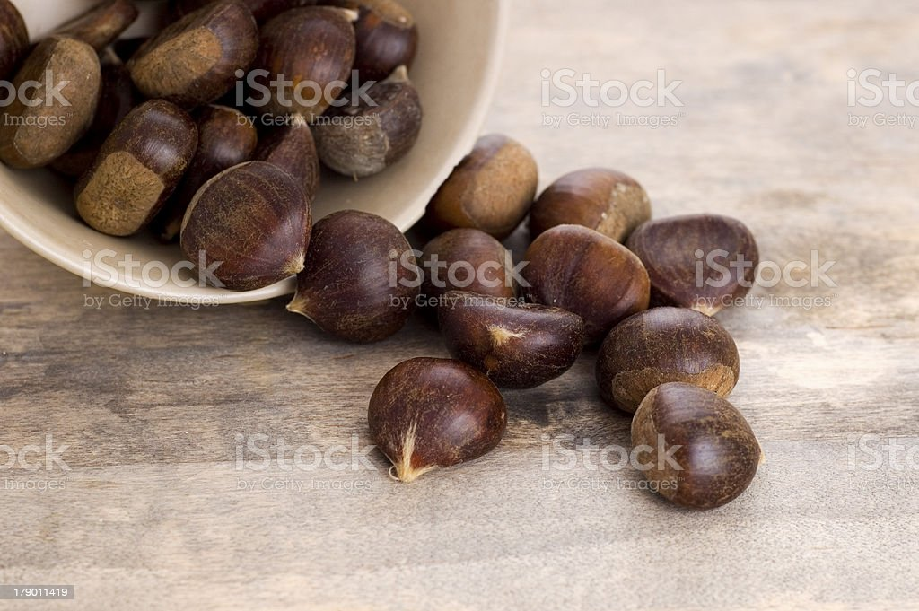 chestnuts on wooden background royalty-free stock photo