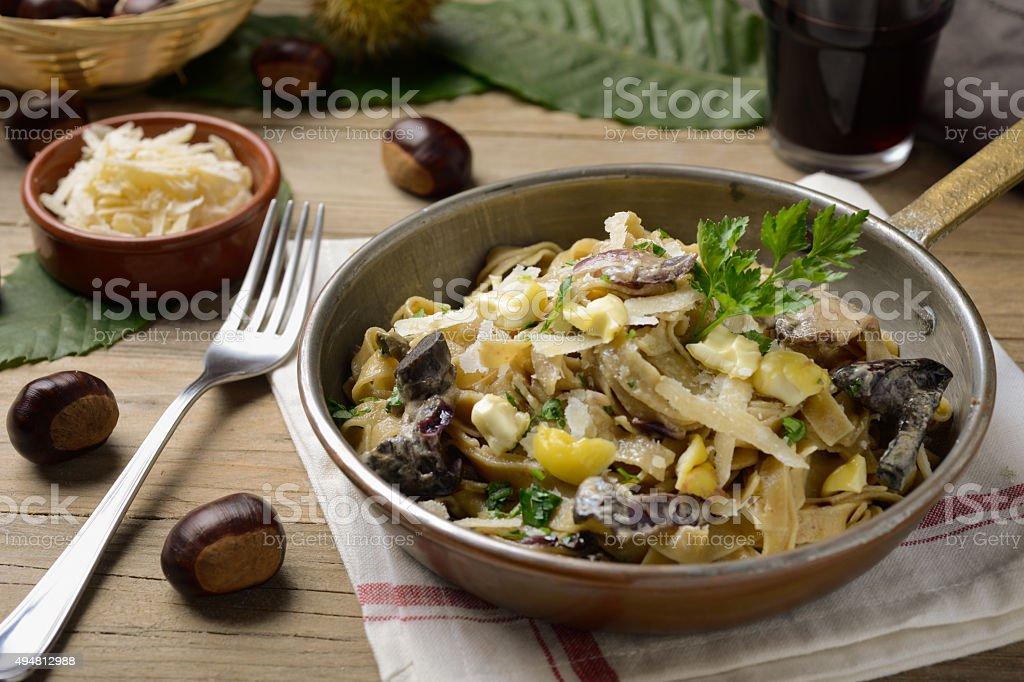 Chestnut's tagliatelle with wild mushrooms sauce stock photo