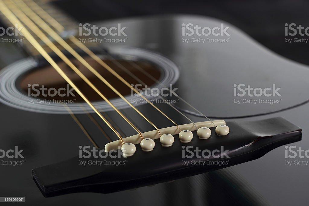 Chevalet de guitare acoustique stock photo