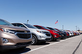 Chevrolet Automobile Dealership with American flag. Chevy is a Division of General Motors