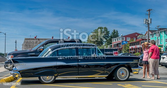 Classic 1957 Chevrolet Bel Air is parked at waterfront parking lot, downtown Lunenburg, Nova Scotia Canada- August 30, 2014.