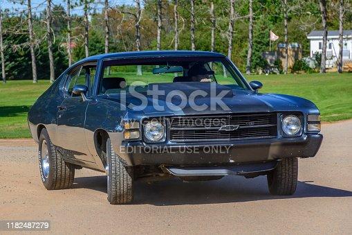 Hilden, Nova Scotia, Canada - September 21, 2019 : Driver leaving car show in 1971 Chevy Chevelle, Scotia Pine Show & Shine at Scotia Pine Campground.