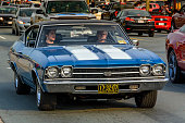 Moncton, New Brunswick, Canada - July 11, 2015 : Driver & passenger cruising in a 1969 Chevrolet Chevelle SS 396 Saturday evening on Mountain Road during 2015 Atlantic Nationals Automotive Extravaganza.