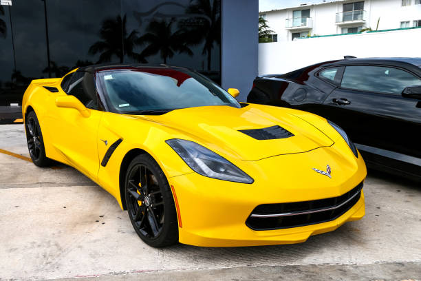 Chevrolet Corvette Cancun, Mexico - June 4, 2017: Yellow american sportscar Chevrolet Corvette in the city street. touring car stock pictures, royalty-free photos & images