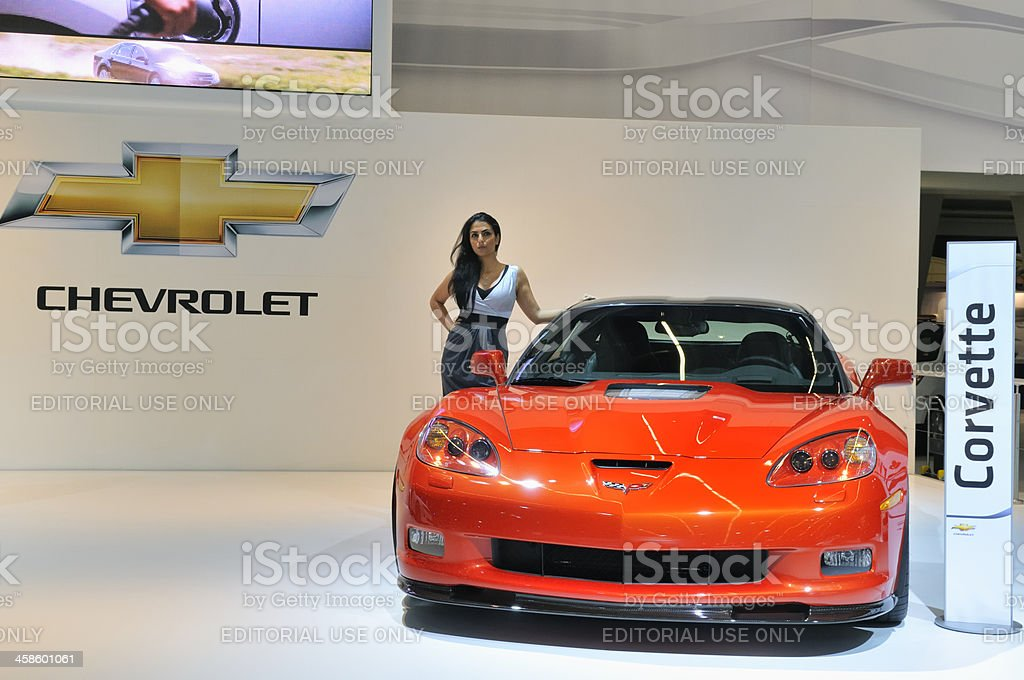 Chevrolet Corvette sports car with a model next to it royalty-free stock photo