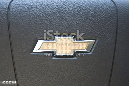 Nashville, Tennessee, USA - April 22nd, 2012: The iconic golden Chevrolet automobile manufacturer's logo, on the leather steering wheel of a new Chevrolet Malibu.