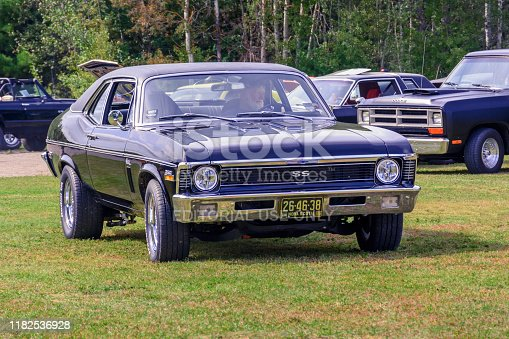 Waterville, Nova Scotia, Canada - September 14, 2019 : Driver and 1969 Chevy Nova SS leaving Rick Rood