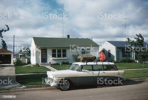 1956 Chevrolet parked in front of 50's home