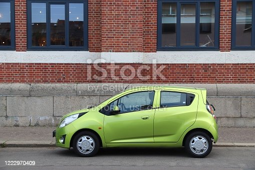Chevrolet Spark green compact hatchback city car parked in Germany. There were 45.8 million cars registered in Germany (as of 2017).