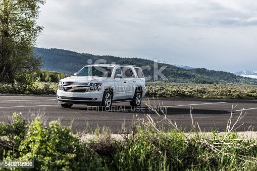 Yellowstone, United States - June 2, 2015: Photo of a Chevrolet Tahoe LTZ at Yellowstone national park,Wyoming, USA. The Tahoe was Motor Trend magazine's Truck of the Year for 1996. It is named for Lake Tahoe on the California-Nevada border in the United States.
