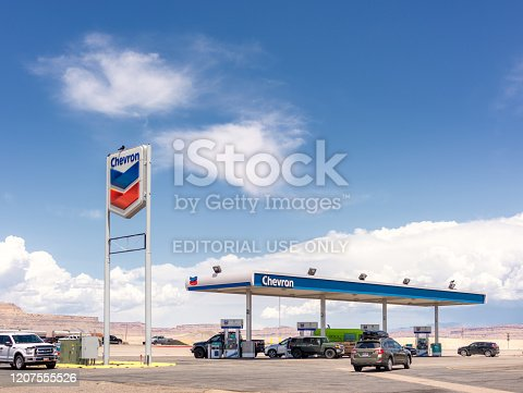Green River, USA - Cars and tracks at the pumps of a Chevron gas station in rural Utah.