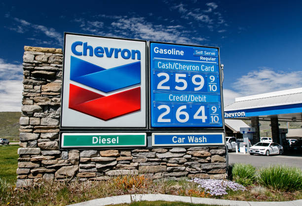 chevron gas station pricing - chevron stock photos and pictures