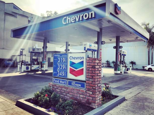 Chevron Gaz Station with Gasoline prices displayed in Santa Monica, California, USA stock photo