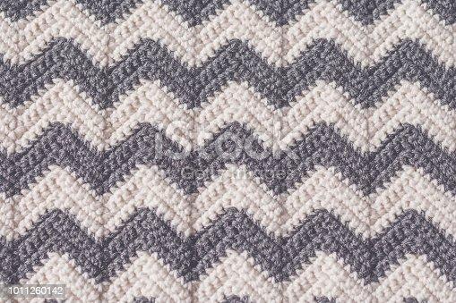 Gray and white ripple striped crochet stitch background