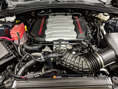 Honolulu - March 29, 2019: Chevy Camaro engine with open Car Hood is displayed at Auto Show.
