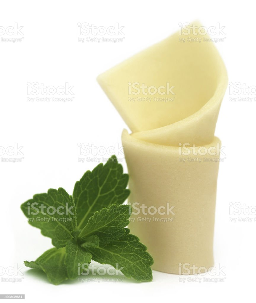 Chewing gum with green stevia stock photo