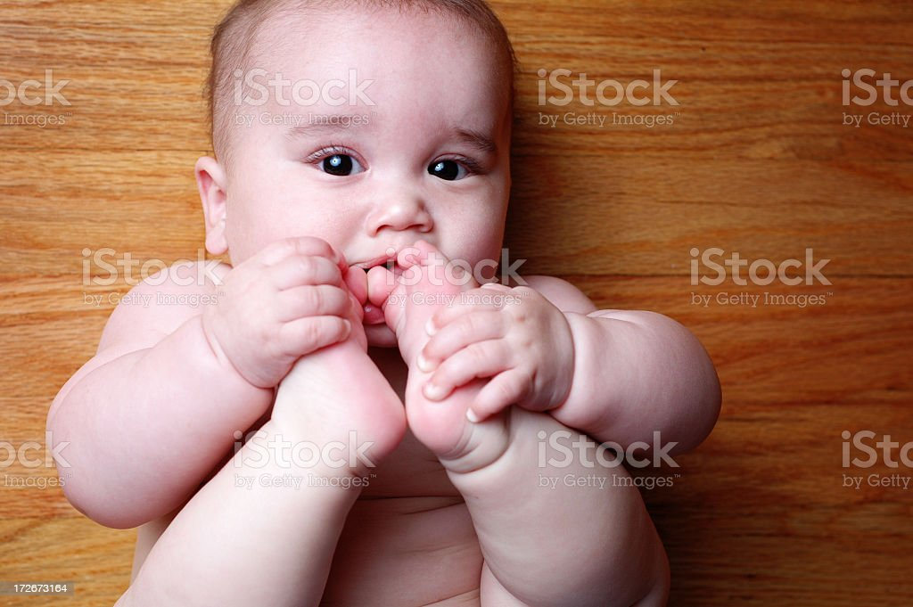 Chewing on Toes stock photo