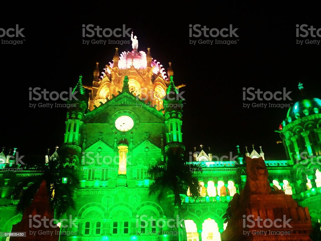Chhatrapati Shivaji Terminus Railway Station Night Light view of Chhatrapati Shivaji Terminus Railway Station of Mumbai, India, previously known as Victoria Terminus. The architecture design has influences from Victorian Italianate Gothic Revival architecture and traditional Mughal buildings. Architecture Stock Photo