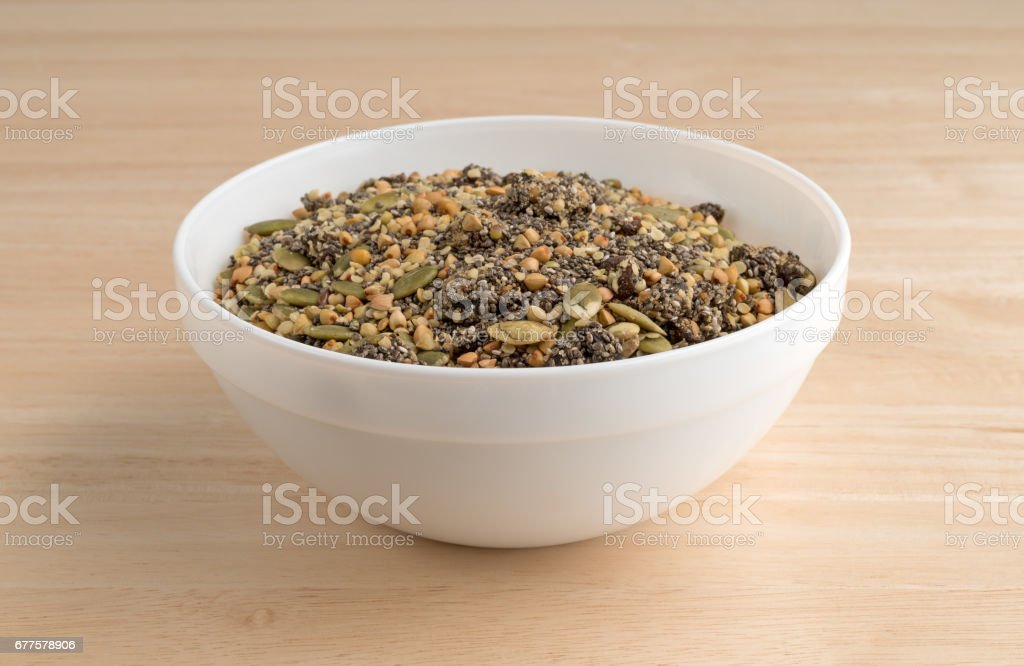 Chia cranberry and pumpkin seeds breakfast cereal in bowl royalty-free stock photo