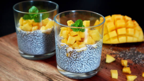 Chia mango pudding on wooden background. Selective focus. stock photo