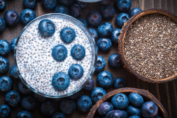 Chia Pudding, blackberry in coconut shell stock photo