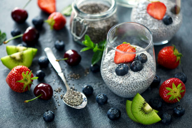 chia pudding with berries, healthy breakfast, vitamin snack, diet and healthy eating - chia seed stock photos and pictures