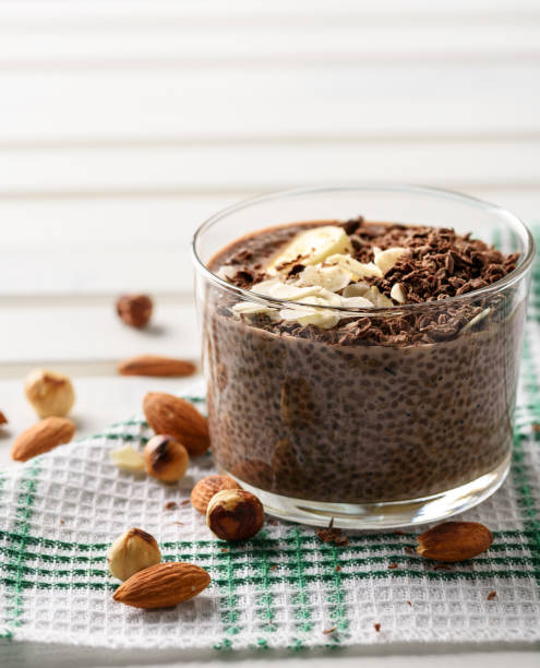 chia pudding with chocolate banana smoothie in a glass jar on the old wooden background chia pudding with chocolate banana smoothie in a glass jar on the old wooden background pudding stock pictures, royalty-free photos & images