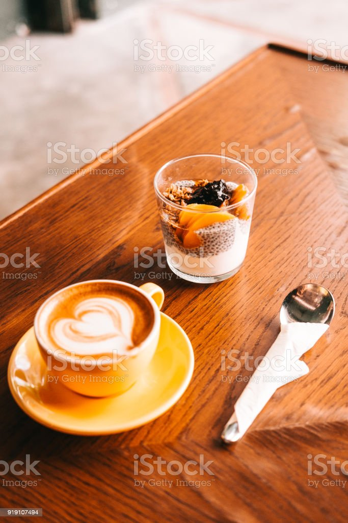 Chia pudding with yogurt on wooden table stock photo