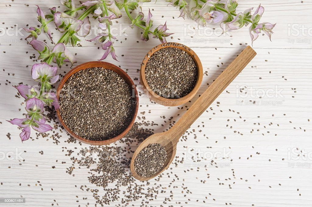 Chia seed healthy super food with flower over white stock photo