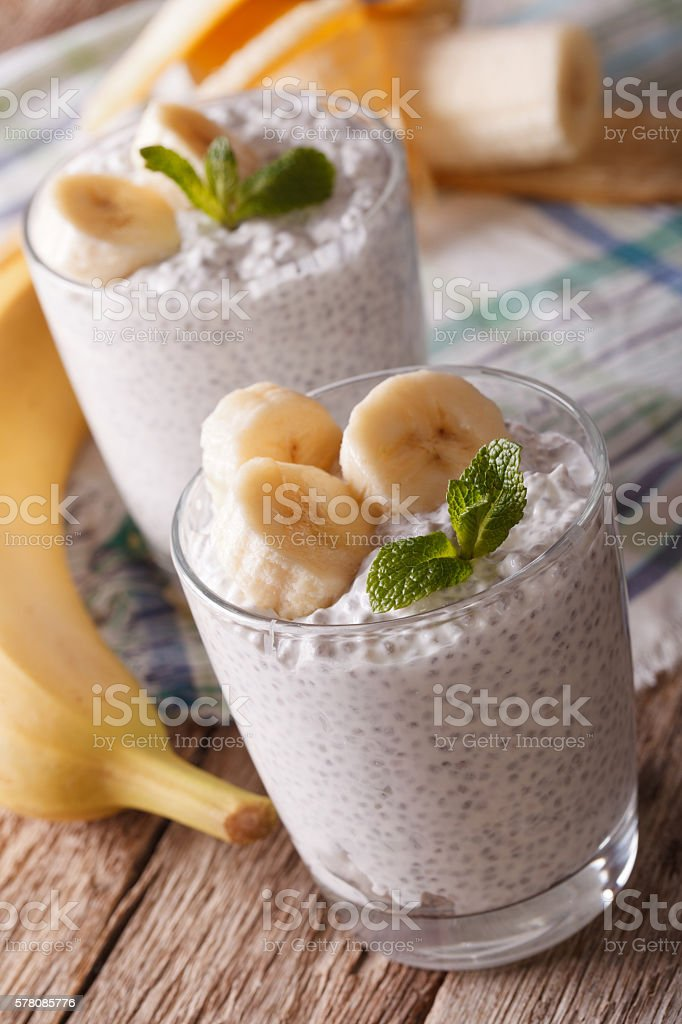 Chia seed pudding and banana close-up on the table. vertical stock photo