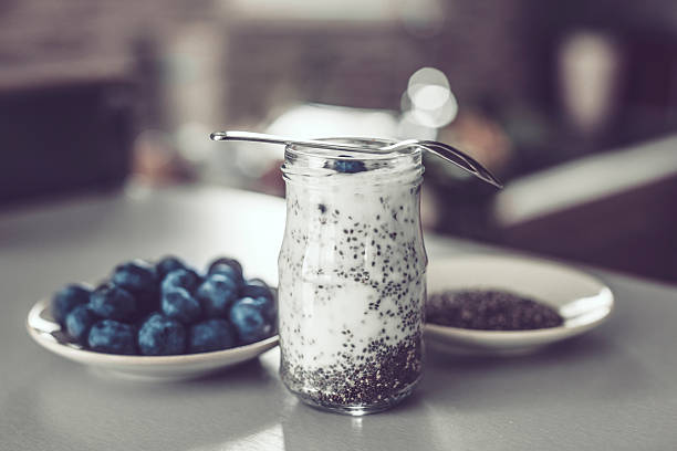 chia seed pudding and blueberries - chia seed stock photos and pictures