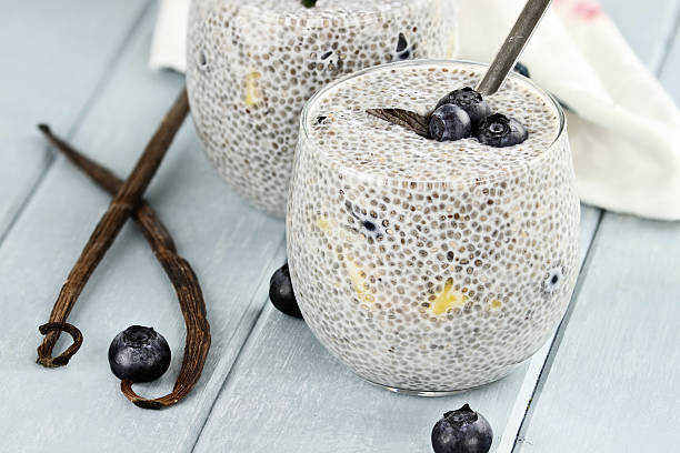 chia seed pudding and fruit - chia seed stock photos and pictures
