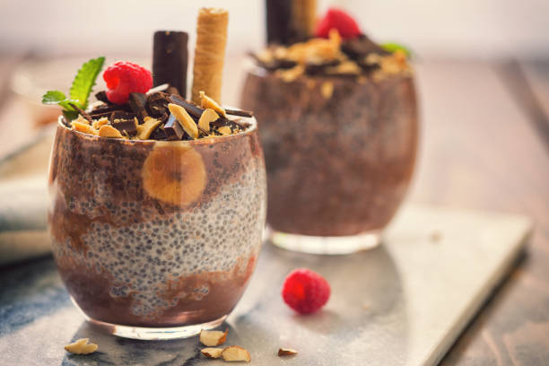 Chia Seed Pudding With Chocolate and Bananas Homemade fresh chia seed pudding with chocolate,bananas,cashew,	 pudding stock pictures, royalty-free photos & images