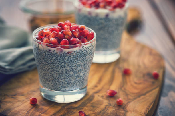 Chia Seed Pudding With Fresh Pomegranates Homemade fresh chia seed pudding with pomegranate seeds pudding stock pictures, royalty-free photos & images