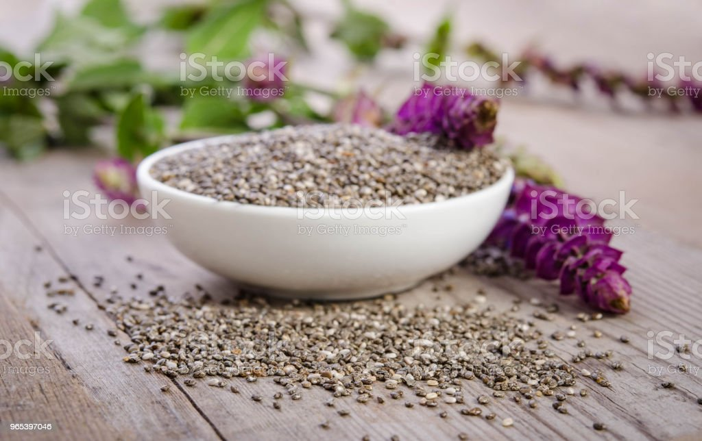 Chia seeds healthy superfood with flower on wooden table royalty-free stock photo