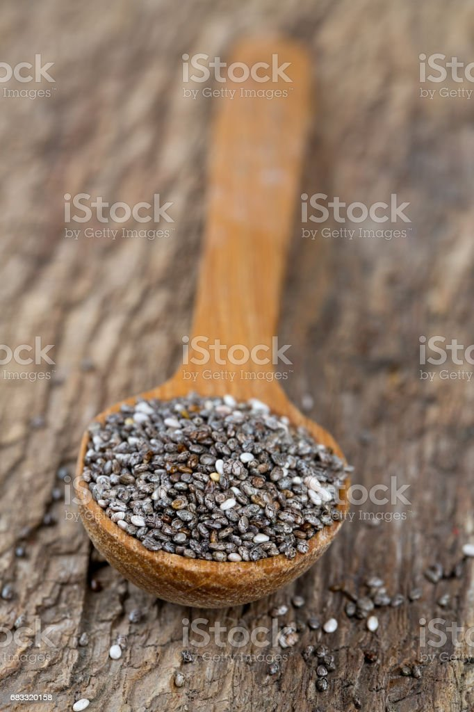 chia seeds in a wooden spoon foto stock royalty-free