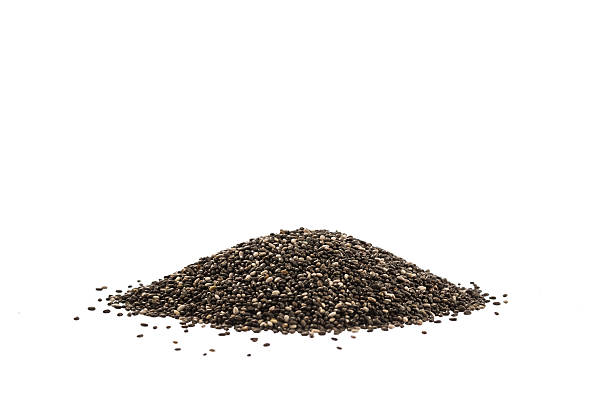 chia seeds isolated on white - chia seed stock photos and pictures