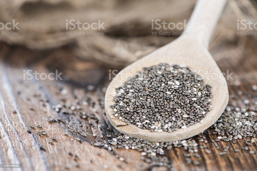 Chia Seeds on a wooden spoon stock photo