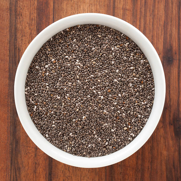 chia seeds - chia seed stock photos and pictures
