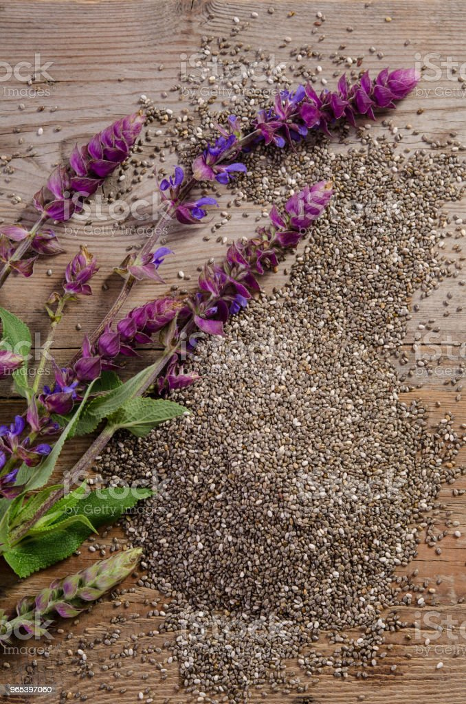 Chia seeds with flowers over wooden table royalty-free stock photo