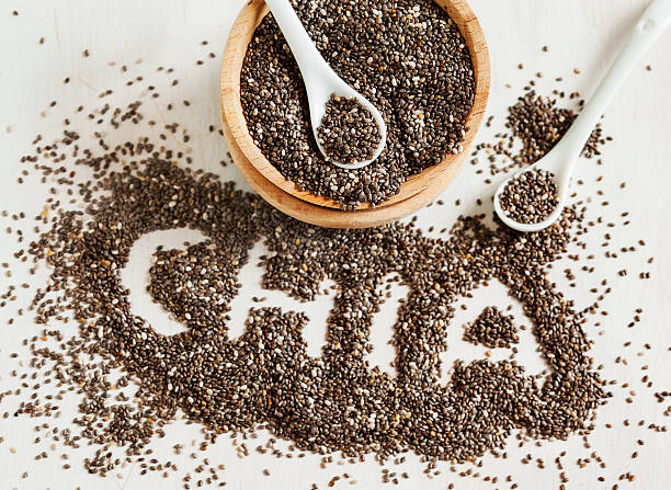 chia word made from seeds. - chia seed stock photos and pictures