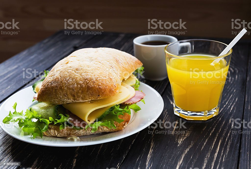 Chiabatta sandwich, cup of coffee and orange juice bildbanksfoto