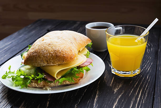 Chiabatta sandwich, cup of coffee and orange juice – Foto