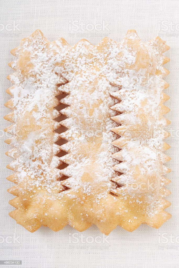 Chiacchiere, italian Carnival pastry on white tablecloth stock photo
