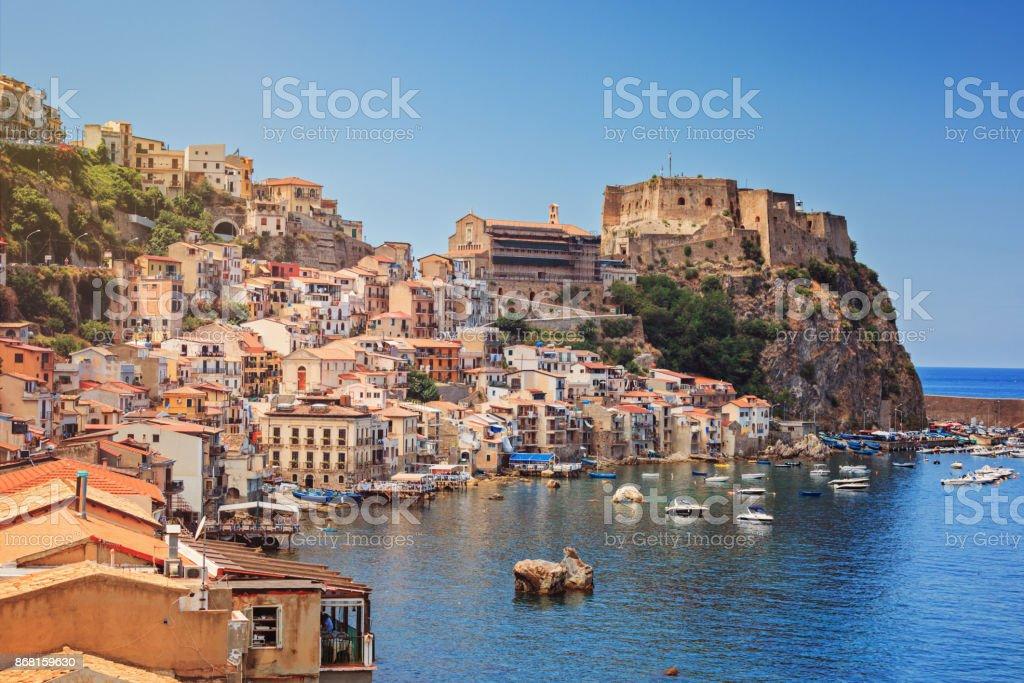 Chianalea di Scilla Scilla castle Ruffo, and harbor with fishing boats in Calabria, southern Italy. Architecture Stock Photo