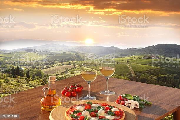 Chianti vineyards with pizza and glasses of white vine italy picture id461215401?b=1&k=6&m=461215401&s=612x612&h=fvzeibdljj6dlkvi rw4weo3z9fy7id9ubi 03fnf2u=
