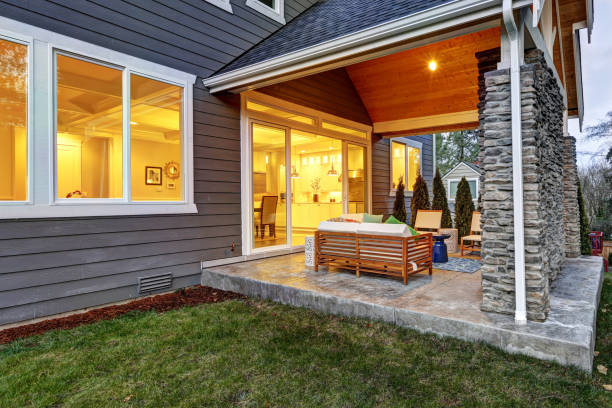 chic covered back patio with stone wall - patio stock photos and pictures