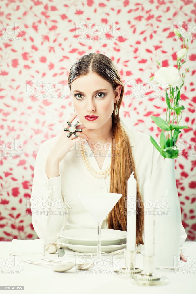 Chic dinner, elegant woman dinning in a white atmosphere. royalty-free stock photo