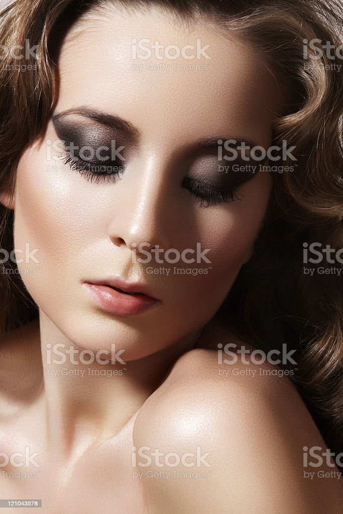 Chic diva with beautiful curly hairstyle, fashion dark make-up stock photo