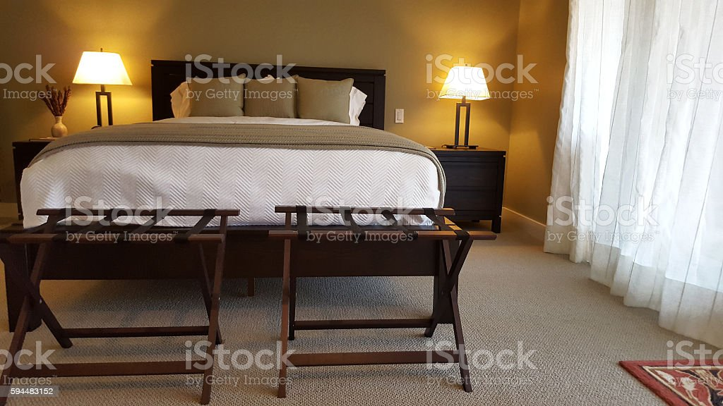 Chic Guest Bedroom With Luggage Racks Stock Photo - Download Image ...